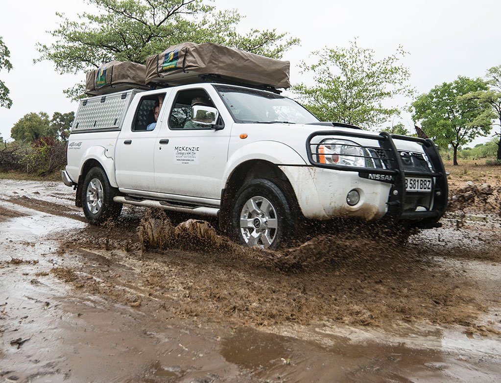 McKenzie 4x4 vehicle crossing Third Bridge in Moremi during wet season