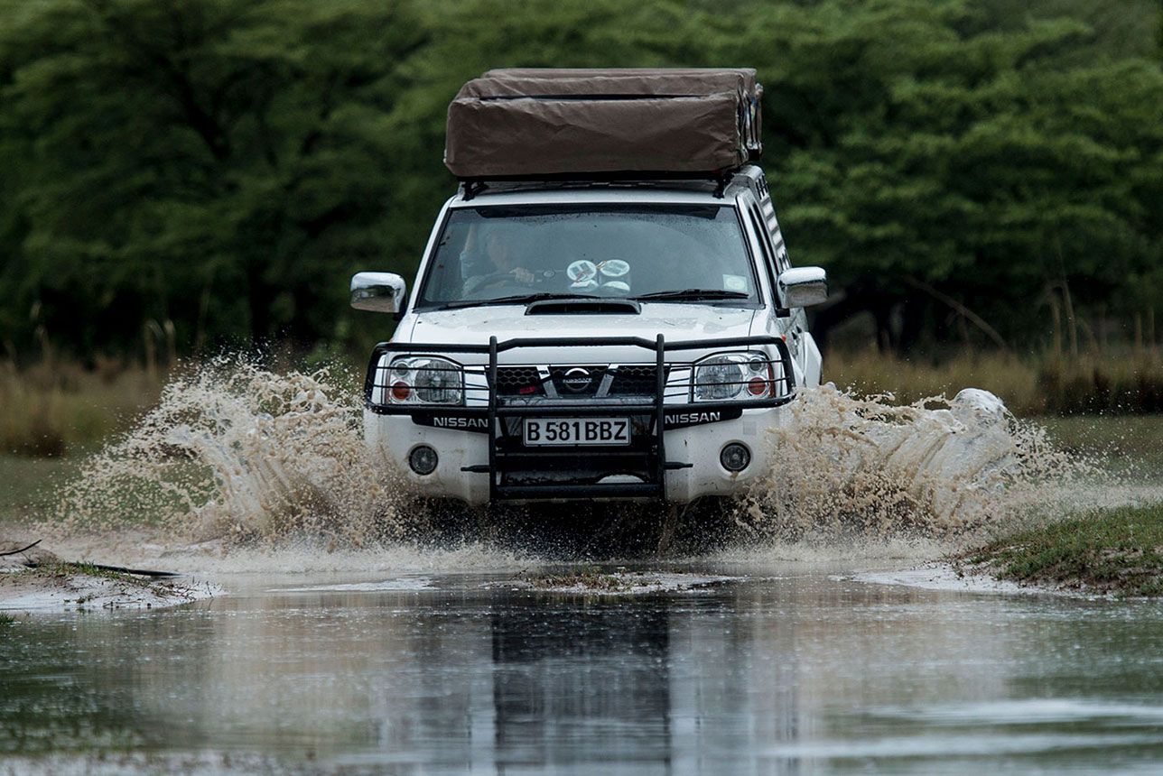 McKenzie 4x4 vehicle in river crossing