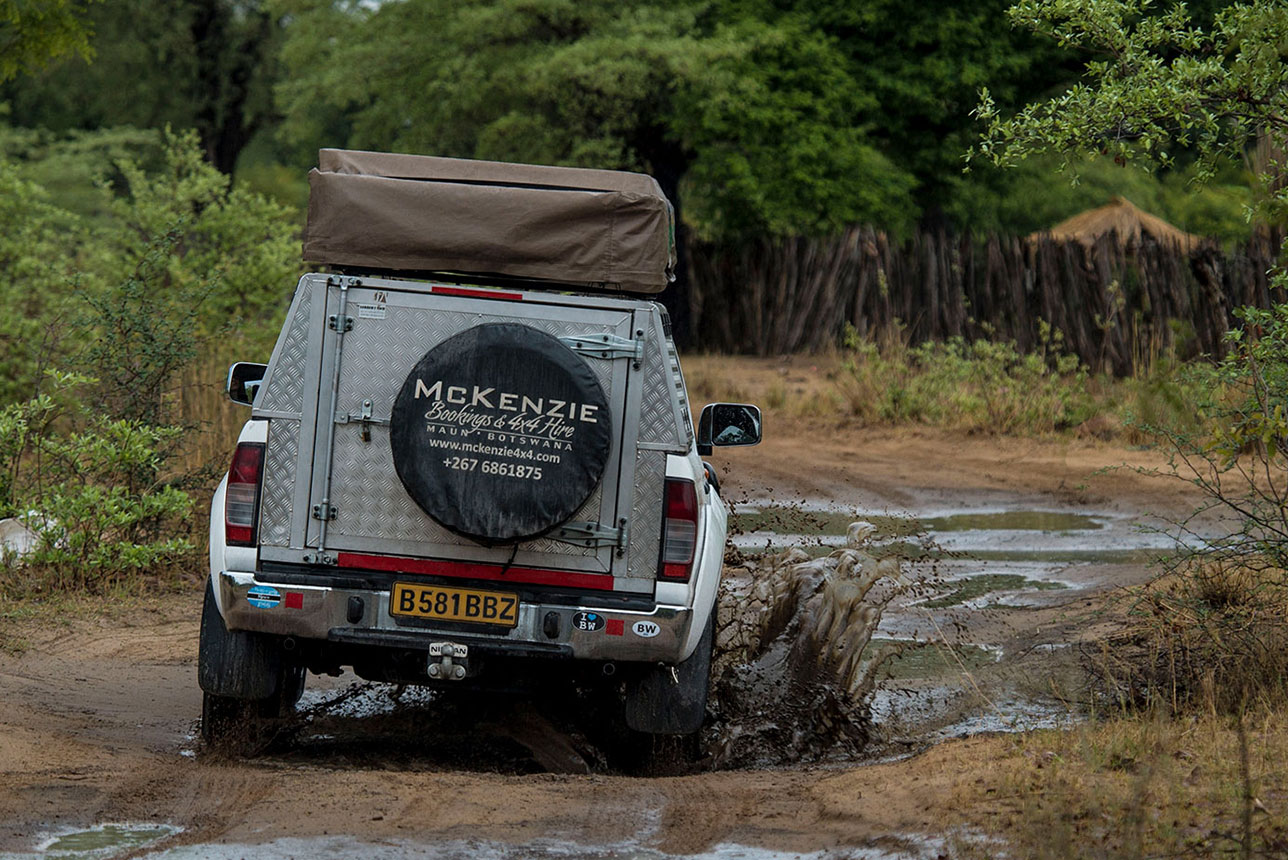 McKenzie 4x4 vehicle driving through the mud in Moremi Game Reserve